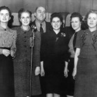 "Thomas ""Tom"" Bevers, who was instrumental in establishing the Fur Rendezvous, here stands with the candidates for Fur Rendezvous Queen on February 4, 1941: Patsy Chisolm, Vivian Fisher Chevillon, Wanda Gelles Griffin, Roberta Lee, and Virginia ""Ginger"" Schodde.  Chisolm was selected as queen.  Bevers was manager of the Fur Rendezvous in 1941."