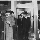 Charles Bush, second from the right, dressed in a suit, stands in the doorway of a store, possibly the Brown & Hawkins store for which he was manager, mid-1920s.  The Brown & Hawkins store was one of the largest in Anchorage, and was closed due to the long economic downtown that affected Anchorage from World War I through the 1920s.