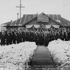 Photograph of members of the Elks (Benevolent and Protective Order of Elks, or B.P.O.E.),  a prominent men's social organization in Anchorage, around 1918.  The large Elks Hall in downtown Anchorage was an important meeting place as well as a center for social events.  Charles Bush was an early member and officer of the group.