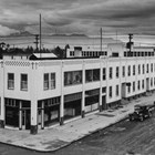First National Bank offices on the Southeast corner of Fourth and G Streets, Anchorage, ca. 1938-1939.  This photograph was taken during the period when Warren Cuddy purchased controling interest in the bank.
