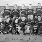 "Anchorage hockey team, now equipped with better uniforms.  Thomas ""Tom"" Culhane is standing on the right end of the back row.  ca. 1937."