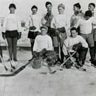 "Anchorage hockey team, probably at the Fairbanks Winter Carnival in 1935.  Thomas ""Tom"" Culhane and Vern Johnson, one of the founders of the Anchorage Fur Rendezvous, are standing at the right end of the group.  Culhane may have learned the game while growing up in Canada."