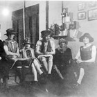 "A view of some of the Anchorage city fathers in drag.  The photograph has been titled ""Going Calling,"" and it was taken in the Anchorage Fire Station on April 6, 1926.  James Delaney is third from the left.  The other men in the photograph are (left to right):  Vic Anderson, Emil Pfeil, Delaney, Ray Matheson, George C. Dickson, and Fred Carlquist."