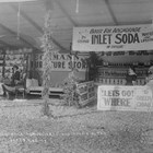 "Eckmann's Furniture booth at the 1917 Anchorage Fair, organized through the Alaskan Engineering Commission (AEC) to showcase local agriculture, industry, and commerce.  Christian ""Chris"" Eckmann was working for the AEC through much of this period; his wife, Louise Leonora, ran the store."
