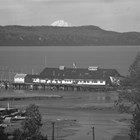 A view of the Emard Cannery along the Anchorage dock, ca. 1940.  Mount McKinley (now Denali) looms on the horizon.
