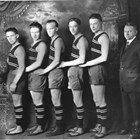 Two of Oscar Gill's teenage sons, William and Victor, stand at the right of this photograph of the 1924 Anchorage High School boy's basketball team. Both graduated in 1925.