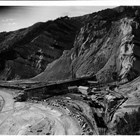 "The Suntrana coal mine at Healy (115 miles south of Fairbanks), 1936.  On July 26, 1950, Austin E. ""Cap"" Lathrop was accidently killed when he fell beneath the wheels of a railroad car at the mine.  This was one of the largest coal mines in Alaska, if not the largest, and is still operated by the Usibelli family as Usibelli Coal Mine, Inc."