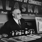 Z.J. Loussac promoting Alaska at a booth at the Seattle Sports and Vacation Show, ca. 1950.