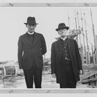 Father O'Flanagan on the left standing beside Bishop Joseph R. Crimont, S.J., Vicar Apostolic of Alaska,  viewing the construction of the original Providence Hospital in Anchorage in the late 1930s.