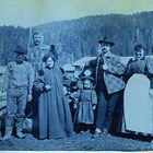 "Martha White among the ""Notables of the Sunrise Hotel"" in 1898.  Photograph taken during Captain Edwin F. Glenn's expedition to Cook Inlet looking for a route into the interior gold fields. Martha White is the third person on the left; next to her is her young daughter, Martha ""Babe"" White."
