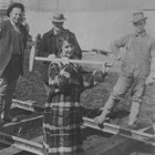 "Martha's daughter, named Martha after her mother but usually known as ""Babe,"" is shown here driving the first spike on a spur line of the Alaska Railroad on April 29, 1915.  This line was built to carry supplies from tidewater at Ship Creek to where the railroad workshops were to be built."