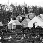 "In 1915, Martha ""Mother"" White moved to the mouth of Ship Creek in expectation of the construction of the Alaska Railroad.  With her she brought two large tents; one functioned as a bunkhouse, the other as a café."