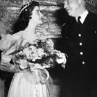 General Simon B. Buckner Jr. chats with Anchorage Fur Rendezvous queen Patricia Chisolm in February 1941.