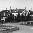 "A view of Christensen Road, which curves uphill from the railroad yards at Ship Creek to what is now downtown Anchorage, where all the streets are straight and meet at right angles.  Many of the Alaska Railroad executives, such as Colonel Frederick Mears, lived in government built houses along the road, in an area known as ""Snob Hollow."""