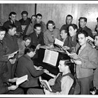 Lorene Harrison was primarily responsible for a weekly sing-along at the USO that was very popular. Lorene was the music director for the USO.