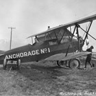 The Travel Air 7000, one of two airplanes owned by Anchorage Air Transport, Inc., when they began business in 1927.  Russel Hyde Merrill was the company's chief pilot.   Although the pilot flew in an open cockpit, passengers or freight were carried in an enclosed cabin just behind the engine.