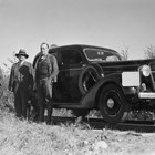 Otto Ohlson (middle) in front of his specially equipped automobile that could run on railroad tracks.  During Ohlson's tenure as manager, he had two cars that were so equipped.  The man on the left of the photograph is B.S. Snell; the man on the right is Colonel L.P. Hunt.