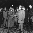 The military need for a closer ice-free port to Anchorage led to the boring of the Whittier Cut-off tunnels and the development of Whittier as a port.  Tunneling was done from both sides, and the final blast connecting the two tunnels occurred on November 20, 1942.  Here Otto Ohlson (left) shakes hands with General Simon Bolivar Buckner, Jr., commander of U.S. troops in Alaska, at the connection point.