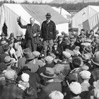 Otto Ohlson addressing the Matanuska colonists in 1936.  Years before the Matanuska Colony had been organized, he had written a pamphlet encouraging homesteaders to come to Alaska and develop local agriculture.  Ohlson was a major supporter of the Matanuska Colony.