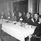 A dinner in honor of Otto Ohlson's retirement from the Alaska Railroad in either late 1945 or very early 1946.  Ohlson is the man fourth from the left; the man third from the left, next to Ohlson, was his replacement, Colonel J.P. Johnson.